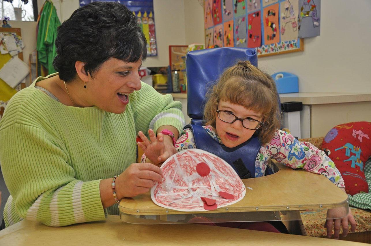 Preschool teacher and child