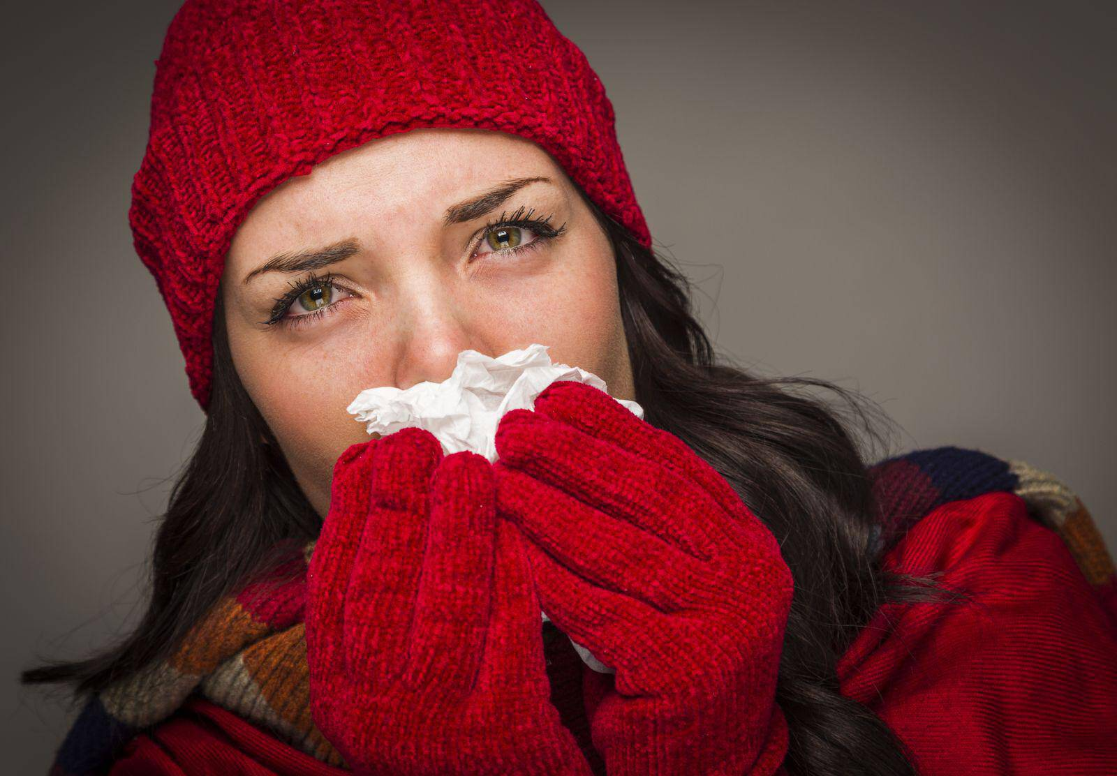 woman-with-cold-blowing-nose