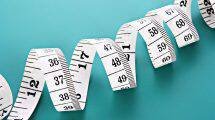 bigstock-Tape-Measure-on-blue-backgroun-16085672