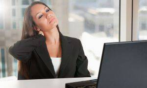 bigstock-Businesswoman-Sitting-At-Her-D-48235118