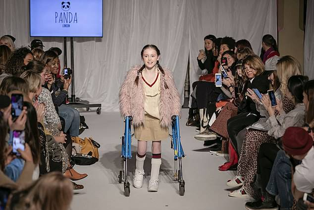 Katie Renshaw walked down the catwalk yesterday modelling clothes for the Panda brand, using a stroller but only for support